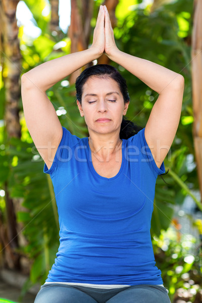 Relaxed woman doing yoga Stock photo © wavebreak_media