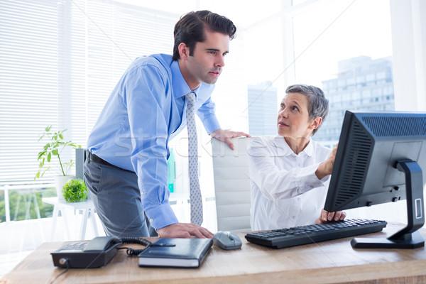 Business people working together on laptop Stock photo © wavebreak_media