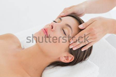 Stock photo: Beautiful brunette enjoying a hot stone massage
