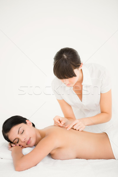 Woman in an acupuncture therapy Stock photo © wavebreak_media