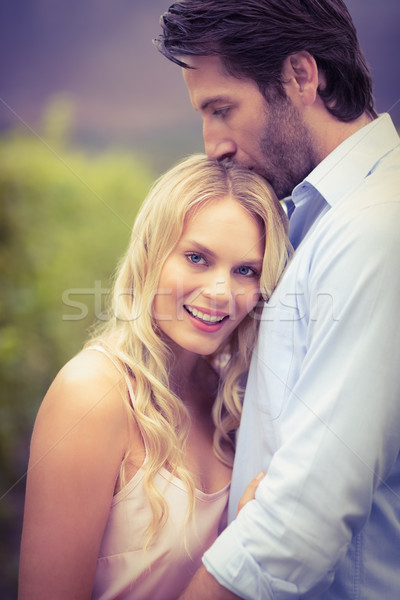 Young happy man kissing woman on the forehead Stock photo © wavebreak_media