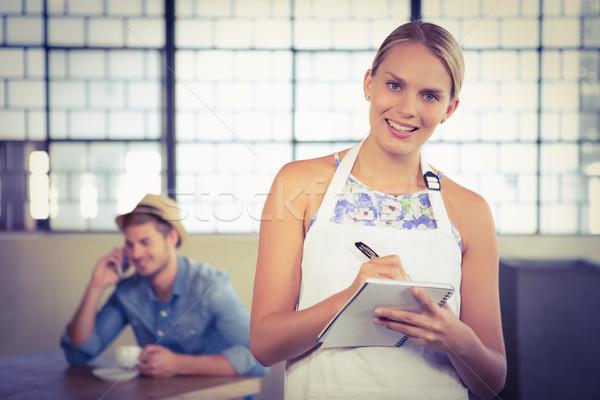 Retrato belo garçonete ordem café Foto stock © wavebreak_media