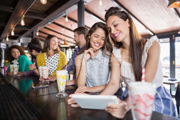 Friends using digital tablet in restaurant Stock photo © wavebreak_media