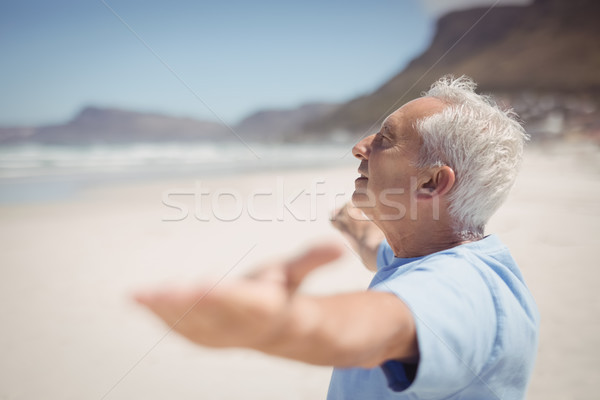 Side view of senior man with arms outstretched at beach Stock photo © wavebreak_media