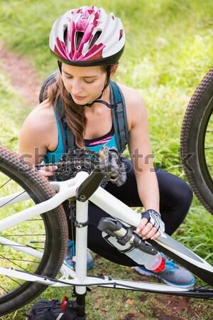 Uśmiechnięty dziewczyna rowerowe lasu dziecko Zdjęcia stock © wavebreak_media