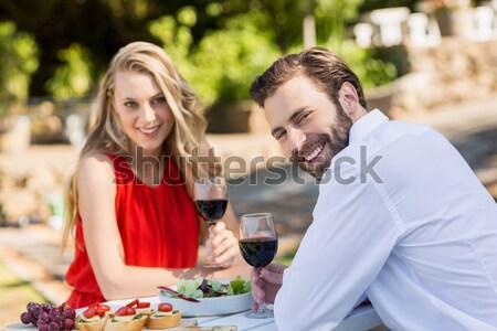 Happy couple toasting wine glass while having meal Stock photo © wavebreak_media
