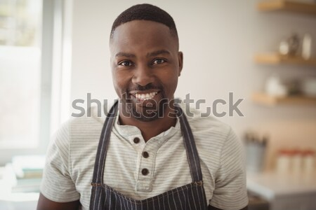 Man standing with arms crossed in restaurant Stock photo © wavebreak_media