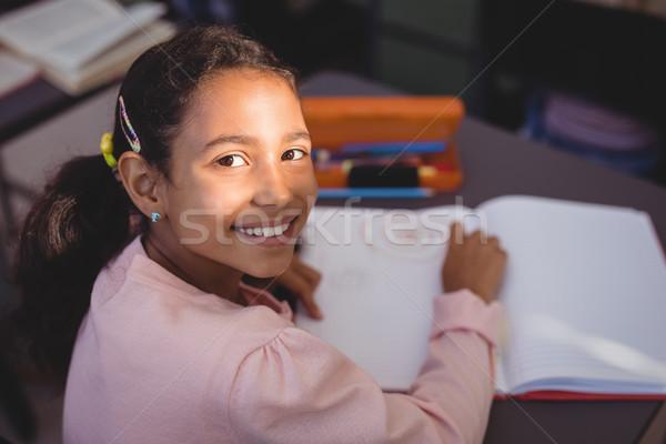 Portré mosolyog iskolás lány házi feladat könyvtár iskola Stock fotó © wavebreak_media
