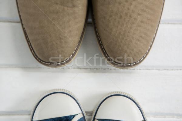 Cropped image of shoes on floor Stock photo © wavebreak_media