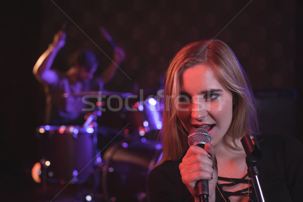 Close up of female singer performing with male drummer  Stock photo © wavebreak_media