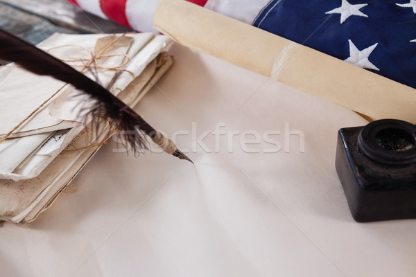 Quill feather and ink pot with legal documents arranged on table Stock photo © wavebreak_media
