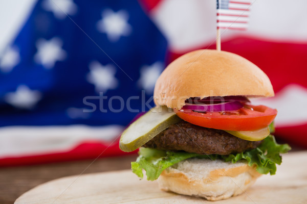 Burger on wooden table with 4th july theme Stock photo © wavebreak_media