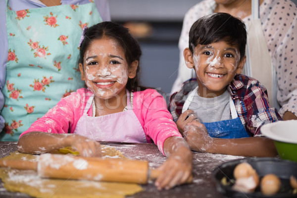 Portrait of smiling siblings with flour on face at home Stock photo © wavebreak_media