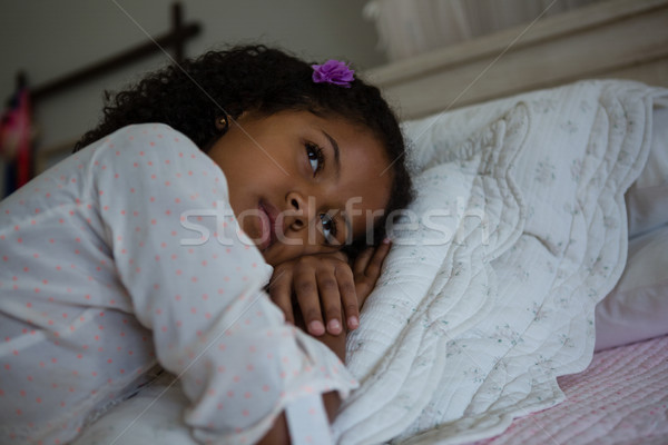 Stock photo: Girl lying on a bed in the bedroom