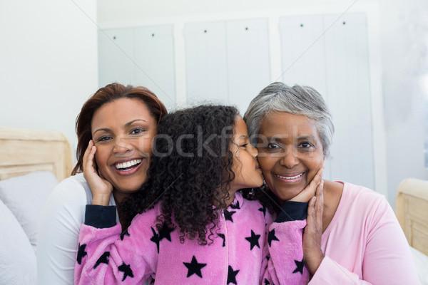 Lánygyermek csók nagymama orcák ágy szoba Stock fotó © wavebreak_media