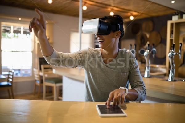 Homem virtual realidade fone digital comprimido Foto stock © wavebreak_media