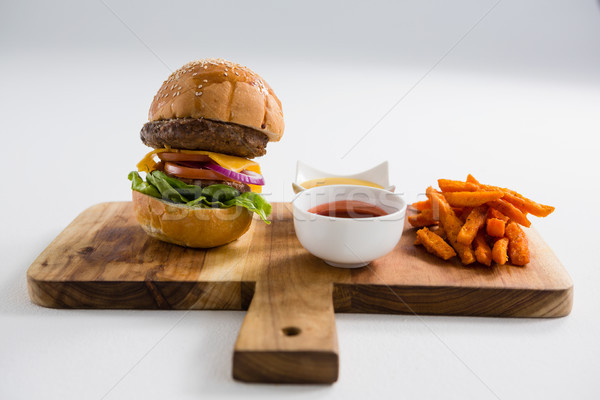 Dips with French fries and burger on cutting board Stock photo © wavebreak_media