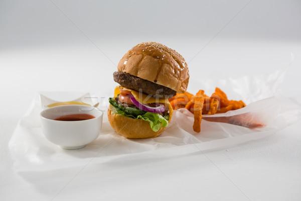 Hamburger patatine fritte ciotola bianco tavola Foto d'archivio © wavebreak_media