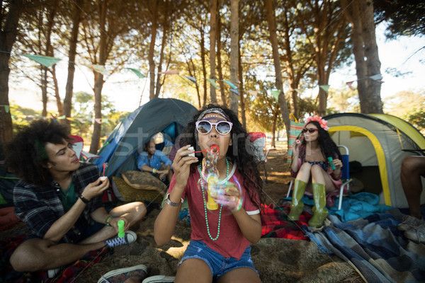 Young woman blowing bubble wand at campsite Stock photo © wavebreak_media