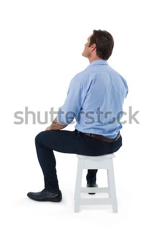 Male executive sitting on stool Stock photo © wavebreak_media