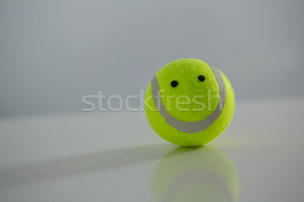 Close up of tennis ball with anthropomorphic face Stock photo © wavebreak_media