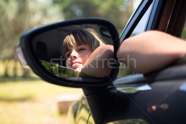 Réflexion adolescente aile miroir voiture Photo stock © wavebreak_media