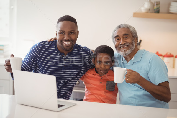 Happy multi-generation family having cup of coffee in kitchen Stock photo © wavebreak_media