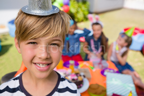 Stock photo: Close up portrait of happy boy with friends in background