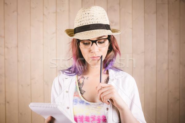 Kadın notepad kalem ahşap Stok fotoğraf © wavebreak_media