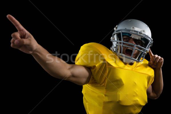 American football player cheering with both his hands raised Stock photo © wavebreak_media