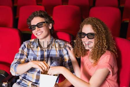 Amici guardare film teatro uomo film Foto d'archivio © wavebreak_media