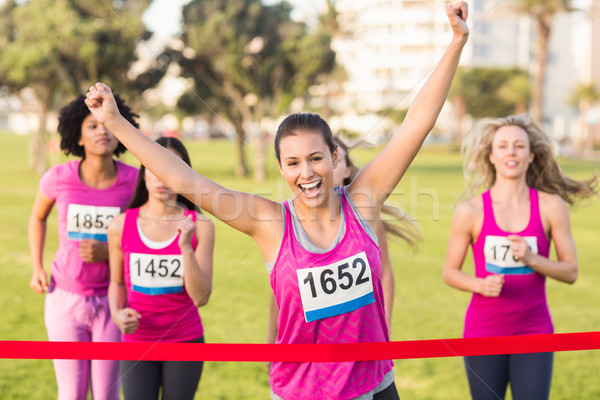 Cheering brunette winning breast cancer marathon Stock photo © wavebreak_media