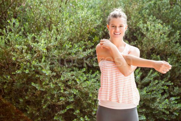 Smiling blonde athlete stretching arms Stock photo © wavebreak_media