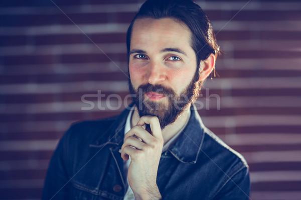 Portret uśmiechnięty człowiek strony podbródek ściany Zdjęcia stock © wavebreak_media