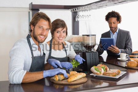 Portrait of smiling female chef and waiter holding plate at counter Stock photo © wavebreak_media