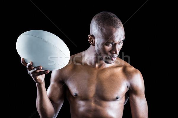 Concentré torse nu ballon de rugby noir Photo stock © wavebreak_media