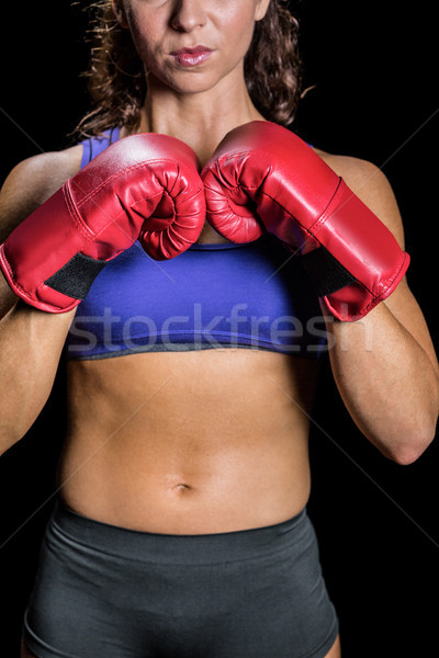 Midsection of female boxer with fighting stance Stock photo © wavebreak_media