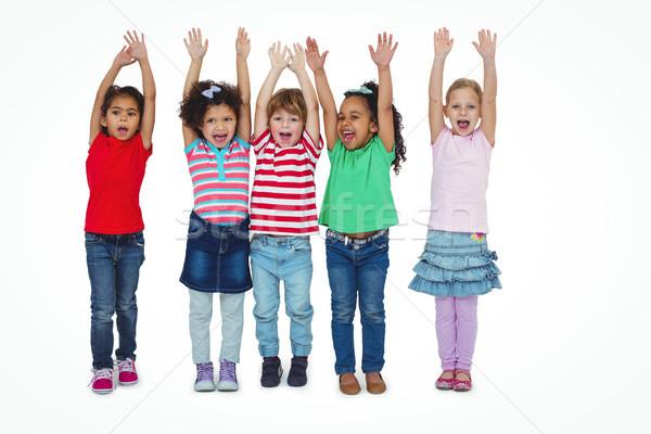 Kis csoport gyerekek áll együtt karok a magasban fehér Stock fotó © wavebreak_media