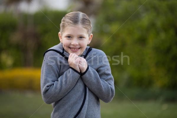 Young girl standing in the park Stock photo © wavebreak_media