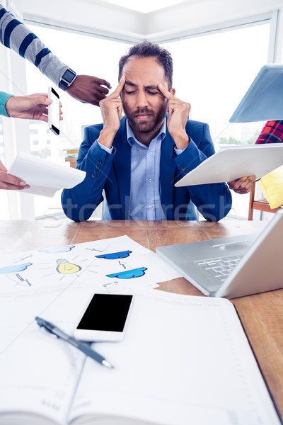 Stock photo: Stressful businessman with head in hands at creative office