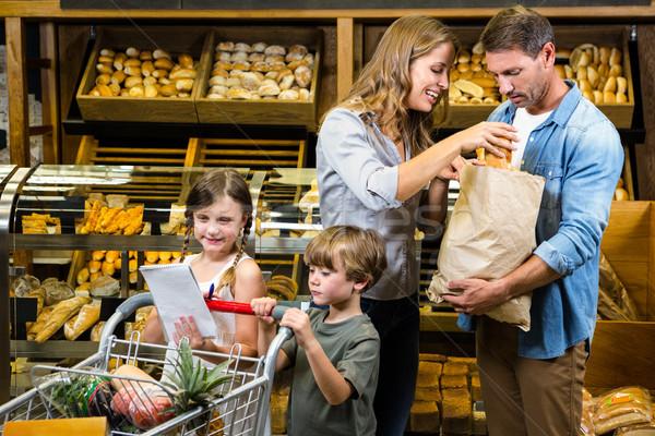 Happy family doing shopping  Stock photo © wavebreak_media