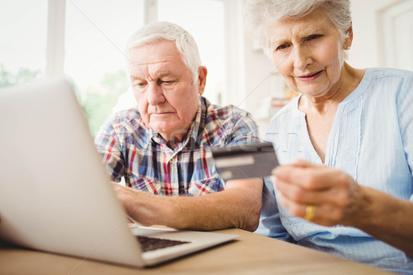 Senior couple paying bills online Stock photo © wavebreak_media