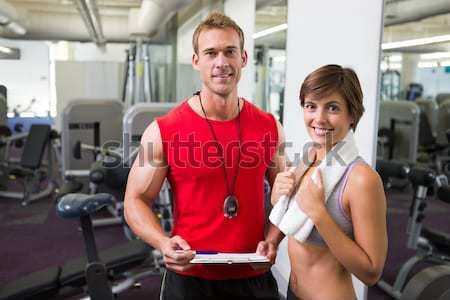 Fit group of people using exercise bike together Stock photo © wavebreak_media