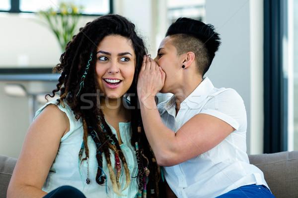 Lesbian couple whispering in ear Stock photo © wavebreak_media