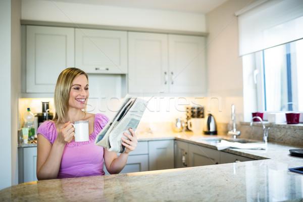 Pretty blonde woman having coffee Stock photo © wavebreak_media