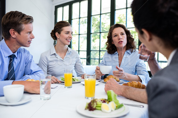 Stock photo: Business people having a meeting in restaurant