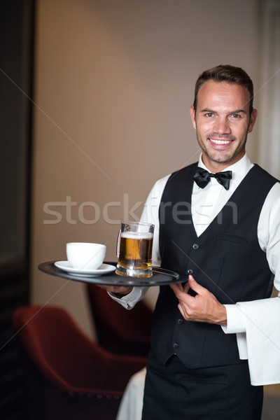 Waiter holding tray with beer Stock photo © wavebreak_media