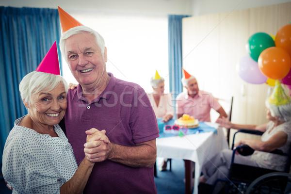 Group of seniors celebrating a birthday Stock photo © wavebreak_media
