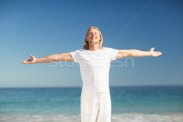 Happy man standing with arms stretched Stock photo © wavebreak_media
