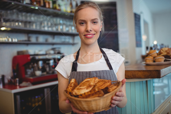 Portrait of confident waitress serving breads at coffee house Stock photo © wavebreak_media